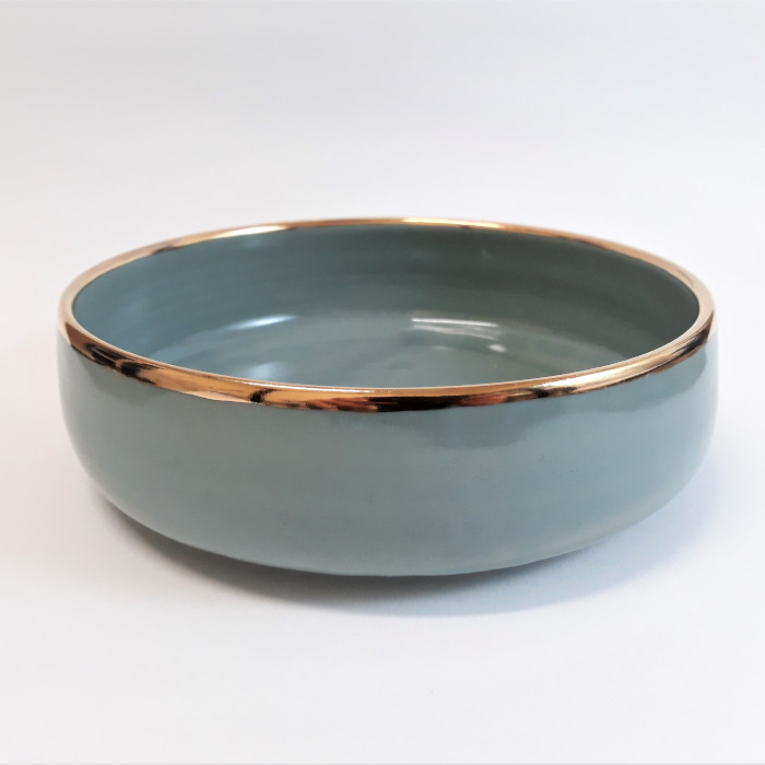 Jade green stoneware bowl with gold lustre trim designed and created by Aisling McElwain