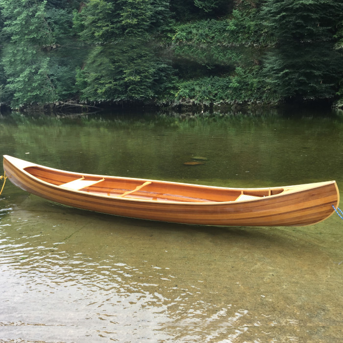 Handcrafted cedar strip canoe designed and created by Eric Phillips