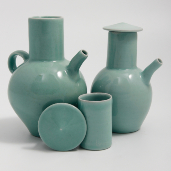 Lidded porcelain pouring vessels with celadon glaze designed & created by Gus Mabelson