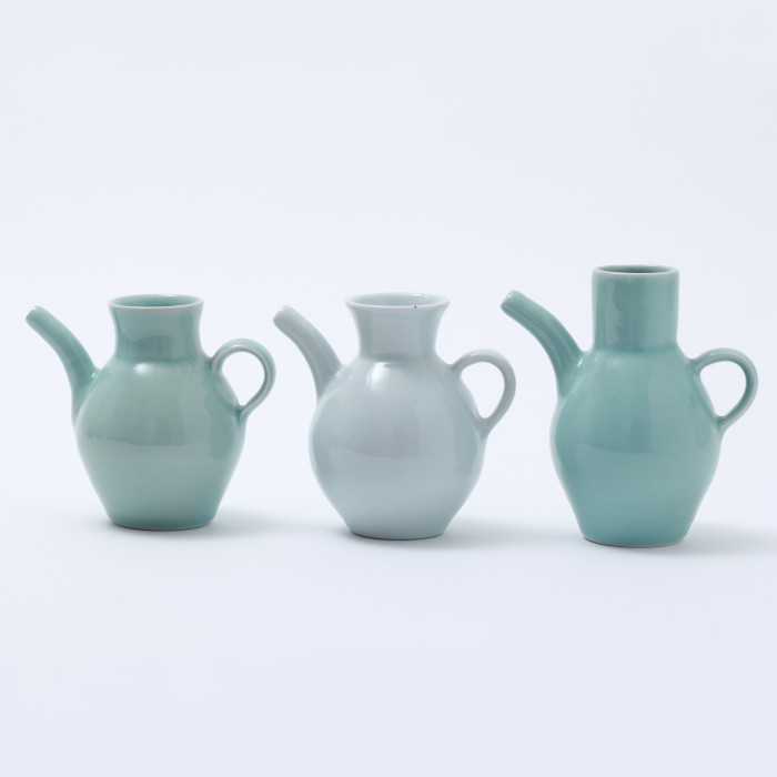 Porcelain pouring vessels with celadon glazes designed & created by Gus Mabelson
